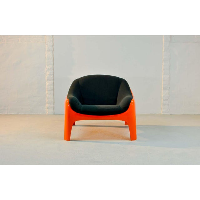 Iconic black and orange colored lounge chair designed by the renowned and multiple honored Italian designer and Artemide...