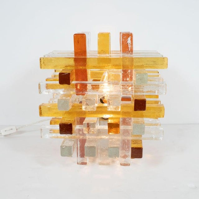 This graphic and sophisticated table lamp was hand blown in Verona, Italy circa 1970. It features a cubic form consisting...