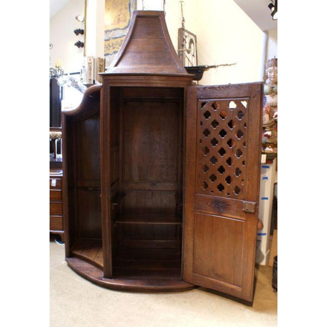 Forgive me Father for I have sinned. I made this fabulous antique confessional into a bar and wine cabinet and I haven't...