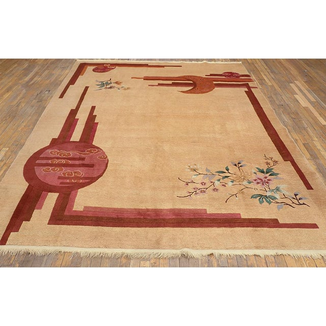 """This is a Chinese art wool rug from China 1930. The size is 8'3""""x10'10"""". The colors are tan, red, orange, green, gray,..."""