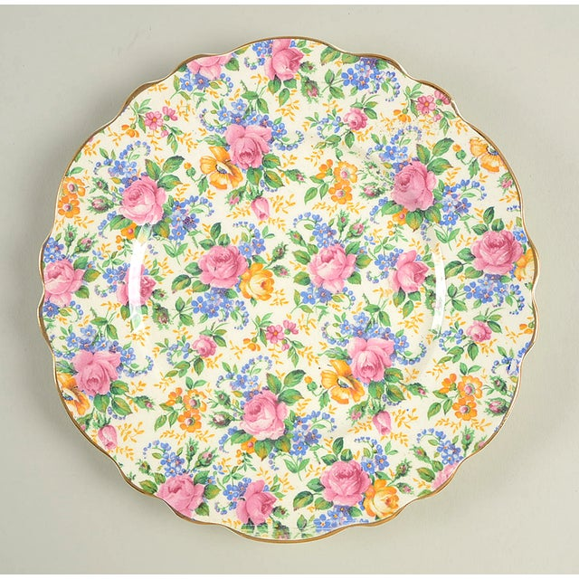 James Kent Rosalynde Chintz Salad Plate Set of 4 features pink, blue and yellow chintz floral pattern with a scalloped...