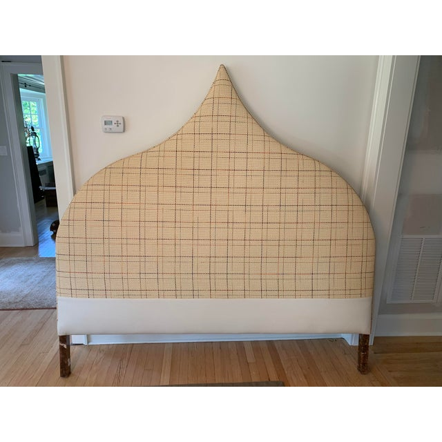 This king size headboard is custom made, heavily weighted and solid. The raffia grasscloth like fabric is extremely durable.