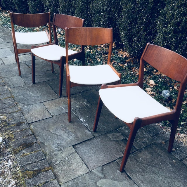 Vintage mid century modern teak chairs (4) from the 1960s. Good looking and versatile chairs Marked on the underside...