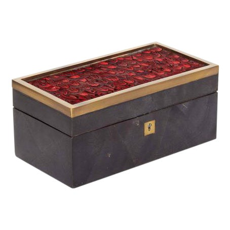 Exquisitely handcrafted decorative or jewelry box. Comprised of lacquered pen shell with geometric patterns in hues of...