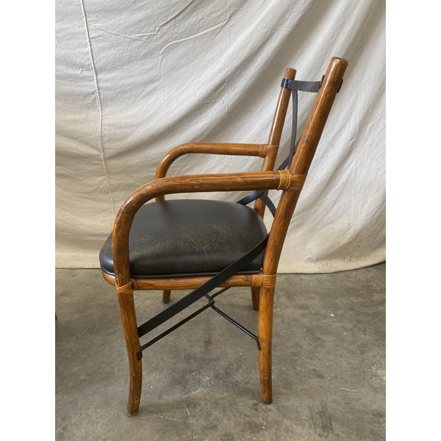 "Stylish set of four Thonet style bentwood dining chairs. This set features bentwood frames, iron ""X"" backs and faux..."