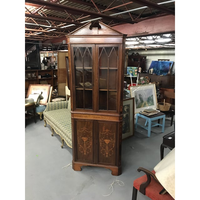 Reproduction veneered inlaid mahogany corner cupboard with shelving for china and inner cupboard. Made in the mid 20th...