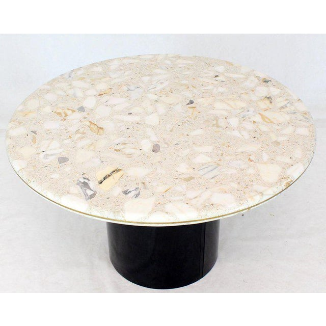 Mid-Century Modern marble-top round black pedestal base dining conference table. Brass inlay trip banding. In style of...