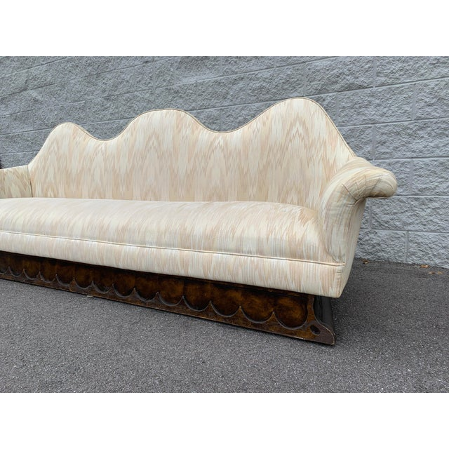 Mid Century Camelback Sofa with Cream Chevron-style fabric. Unlike most camelback sofas with one middle hump, this piece...