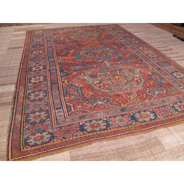 An Oushak, featuring the older design and color palette from this region that predates the western influence and the...