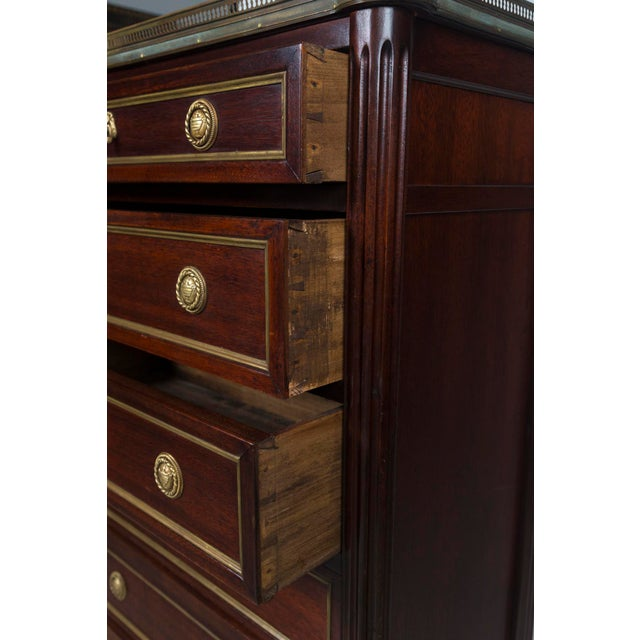 French mahogany Louis XVI style semainier with brass gallery and white marble top. Traditional 7- drawer lingerie chest....