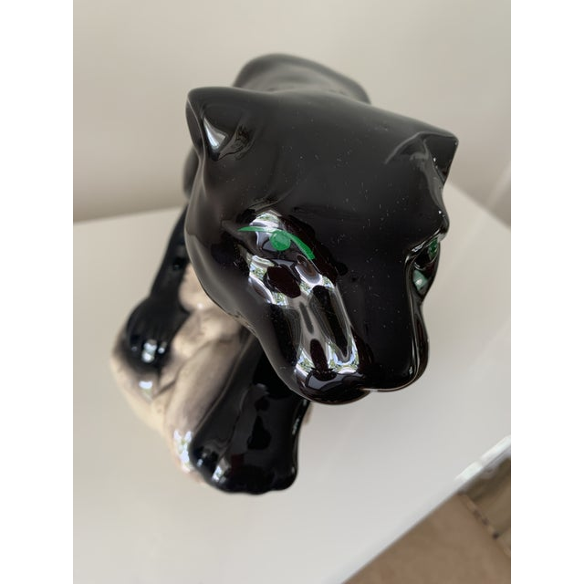 Mid century ceramic black panther on rock. Painted green eyes. Super shiny glaze. No mark on bottom of piece.