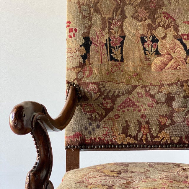 Carved walnut chair with needlework upholstery. Height: 46″ / Seat Height: 18.5″ Width: 27″ Depth: 33″
