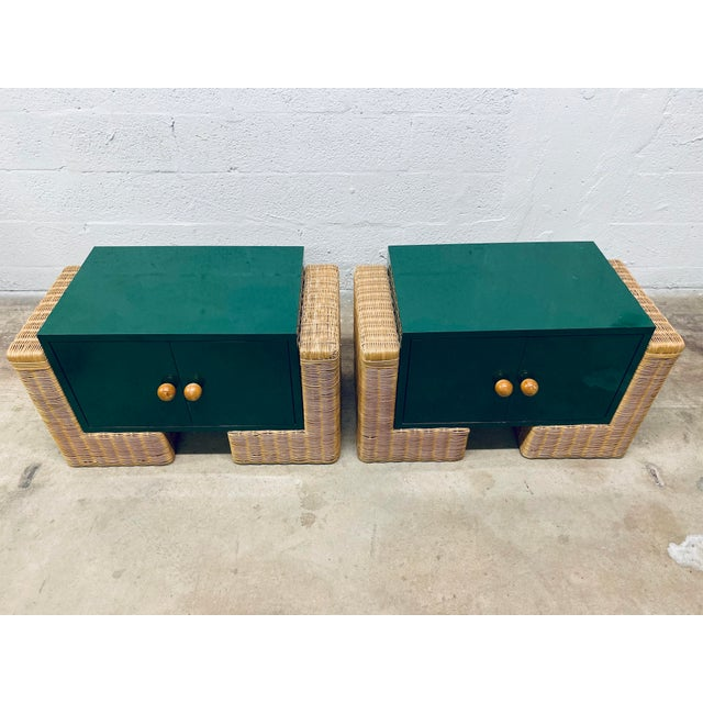 Pair of 1970s modern rattan / wicker nightstands with suspended green laminate storage. The beside table doors have chunky...