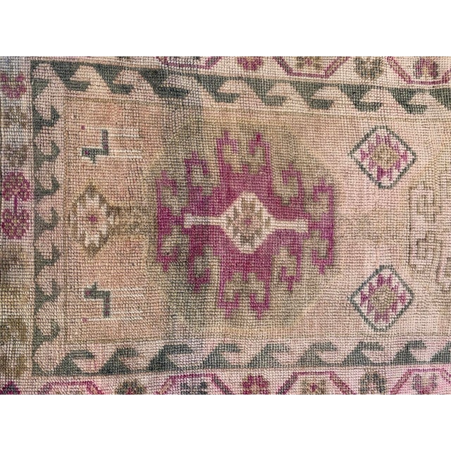 Beautifully faded, handmade Turkish Oushak runner in muted sand, green and pink tones.