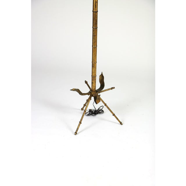 This listing is for a Midcentury gilt tole bamboo-form floor lamp. It is French in origin circa 1950 with decoration...