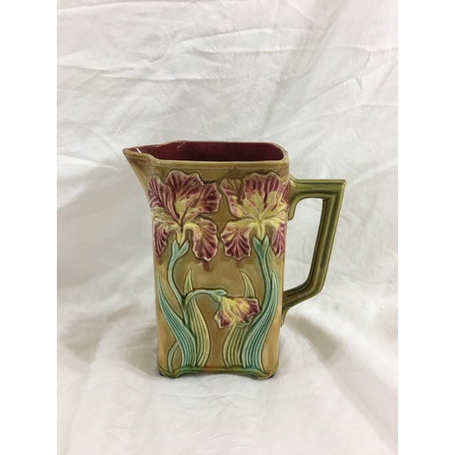 This very sweet Majolica pitcher dates from the 1870's and is in near perfect Condition. Featuring yellow and mauve...