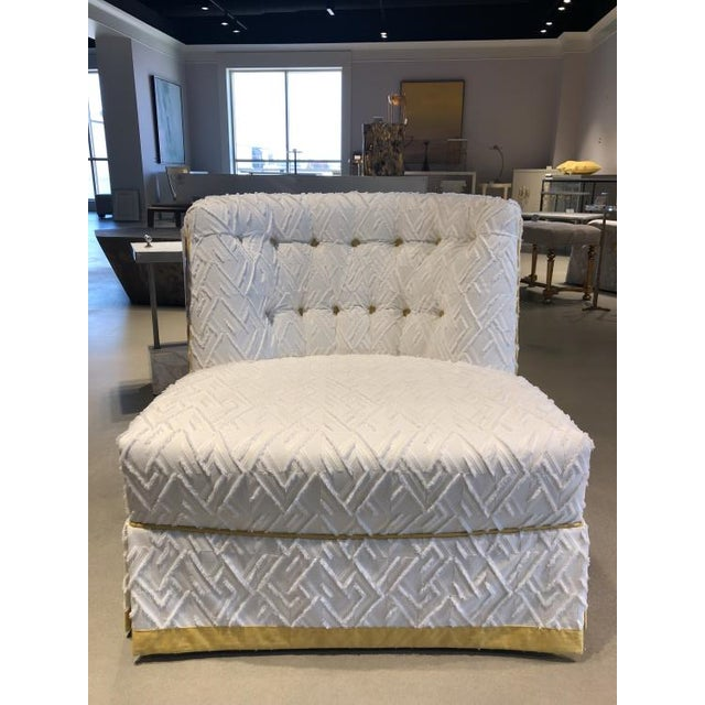 The Juniper Skirted Chair is a first quality showroom sample that features a white patterned fabric with a yellow skirt...
