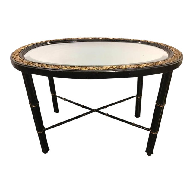 Hollywood Regency Beveled Mirror Top Black Oval Coffee Table With Bronze Mounts For Sale