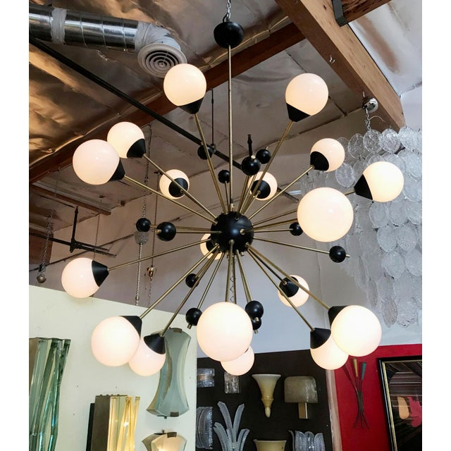 Vintage Italian mid-century Sputnik chandelier with glossy white Murano glass globes, black enameled frame and brass rods...