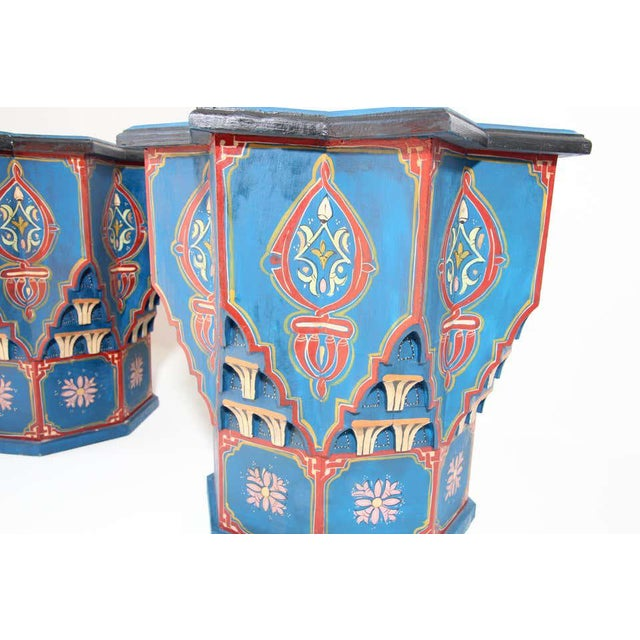 Pair of Moroccan colorful blue hand painted and carved side occasional table with Moorish Islamic designs. Pedestal tables...