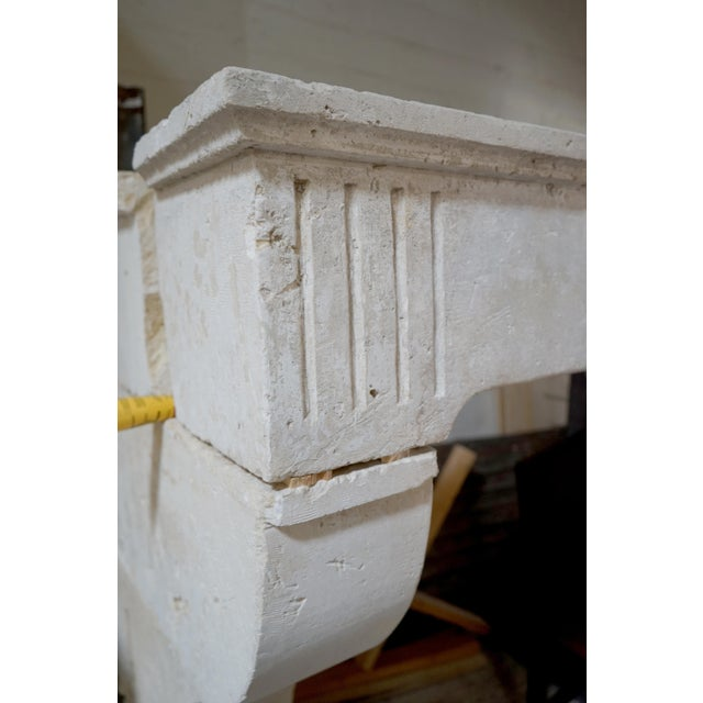 This antique limestone mantel features simple lines that add a touch of elegance to your room setting. Origin: France,...