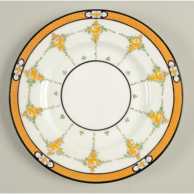 Minton #B930 Salad Plate S/8 features a yellow band, yellow roses, black trim and accent lines. Each plate has some...
