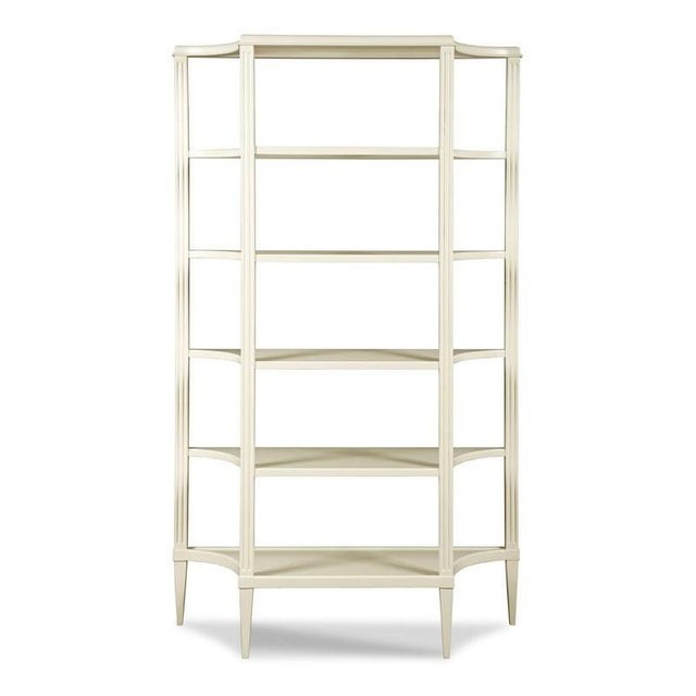 A graceful bookshelf with classical styling from the 18th Century. The case has squared fluted posts that hold five...