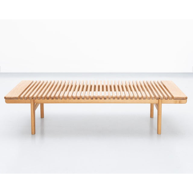 A rare and early bench by Hans Wegner in ash for Johannes Hansen. Limited production, Denmark, 1953.