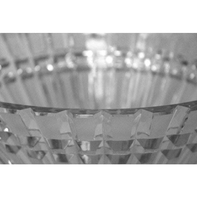This great bowl with a simple cut glass pattern features a square-pattern top row and an elongated lower row that looks...