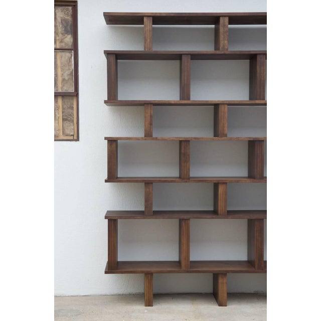 Tall 'Verticale' shelving unit made of stained hardwood. Sealed with a soft, matte finish. Handmade in our Los Angeles...