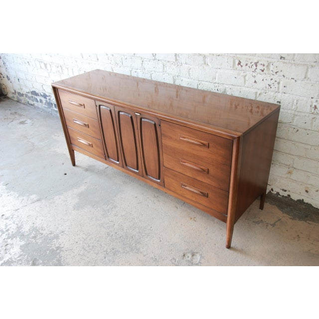 Broyhill Broyhill Emphasis Mid-Century Modern Sculpted Walnut Triple Dresser Credenza For Sale - Image 4 of 12