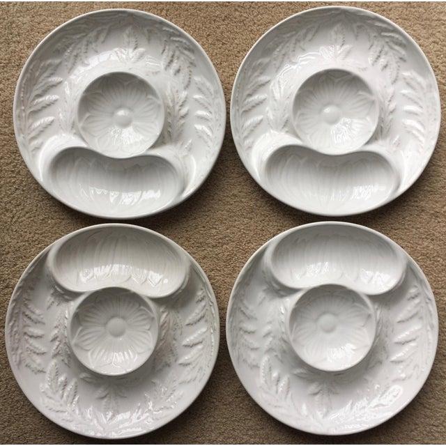 This lovely se of 4 white Portuguese Majolica artichoke plates are in excellent unused condition, original stickers still...