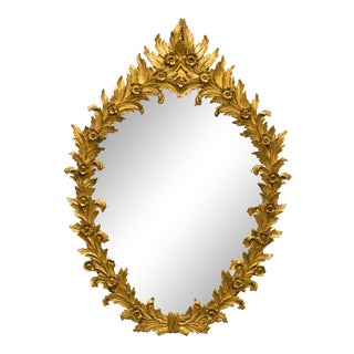 1960s Italian Carved Wood Floral Gilt Mirror. Pair available. For Sale