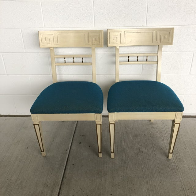 Rare vintage Klismos style dining chairs with Greek key details and curved back Total of 6 side chairs available and 2 arm...