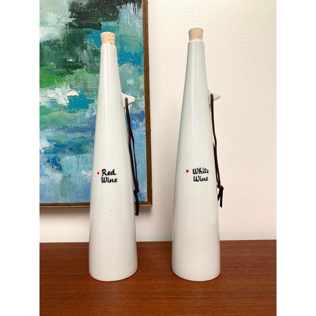 Set of 2 wine decanters designed by Kenji Fujita of Tackett Associates for Freeman Lederman ca. 1950s/60s. These bottles...