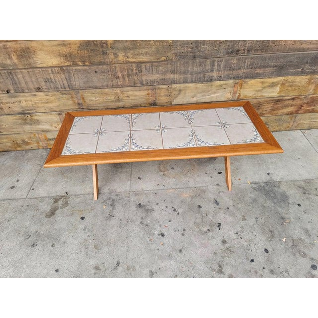 1980's vintage oak wood X legs and beautiful tile top coffee table. It was custom made for its last owner.