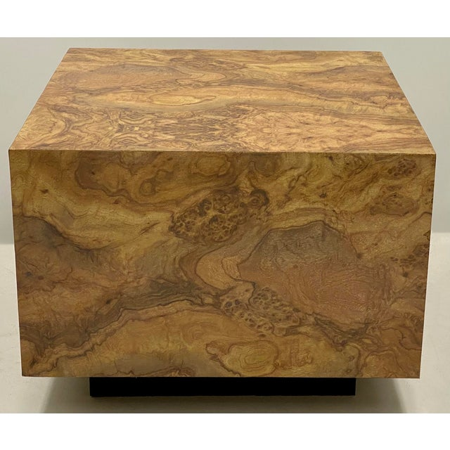 This is a modern faux burl laminate coffee table in very good condition. The square base is black.