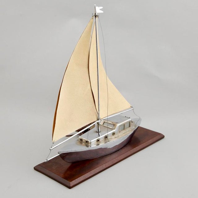 1930's French decorative lamp is a sailboat rendered in silver tone metal mounted on wood base with shagreen and copper...