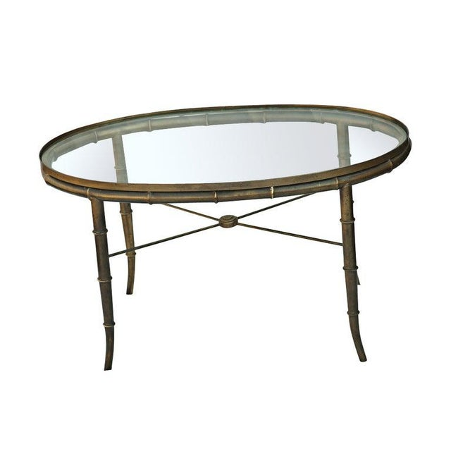 Mastercraft Brass Bamboo Oval Cocktail Table made in the 1960s A classical style bamboo frame with an inset glass top.
