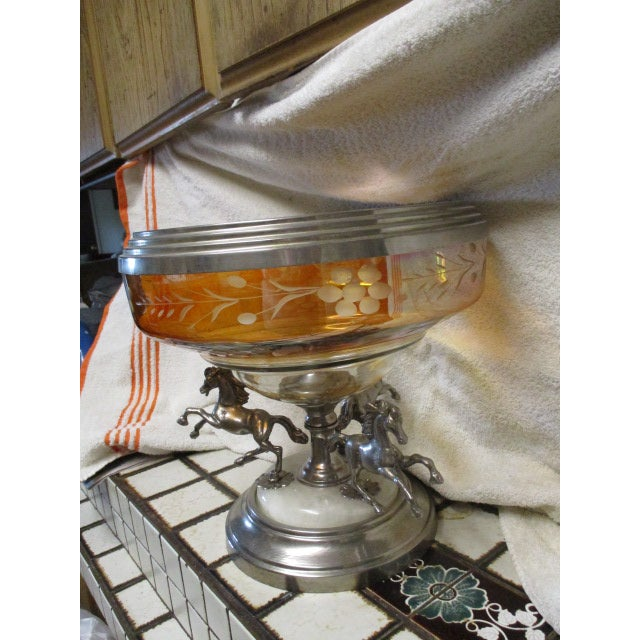 A Bohemian Metal Mounted Glass Epergne The circular amber flash glass bowl engraved with bands of stylized berries and...
