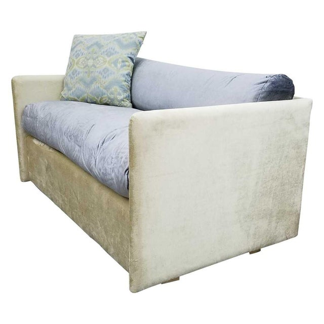 Wood frame with velvet cotton blend upholstery. Seat cushion: Down and feather wrapped foam. Back cushion: 50/50 down and...