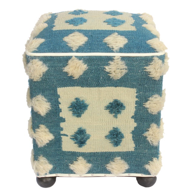 Chic handmade ottoman crafted using wood and upholstered using hand woven kilim is a multi-purpose fashion pouf which will...