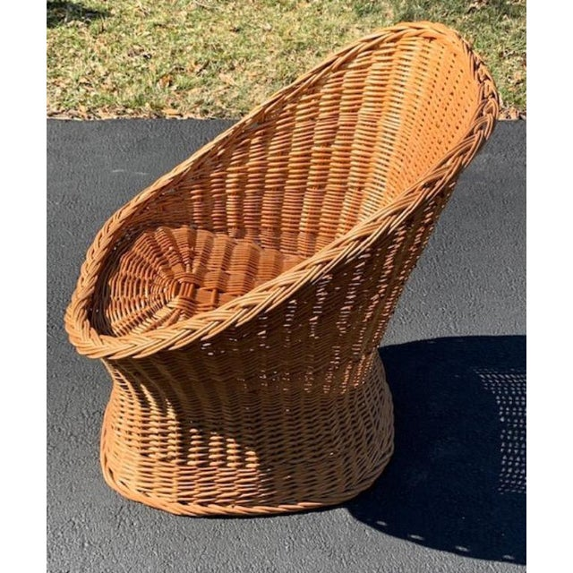 Tightly woven rattan bucket chair. A nice angled back that makes it a comfortable seat. Add a colorful seat cushion and...
