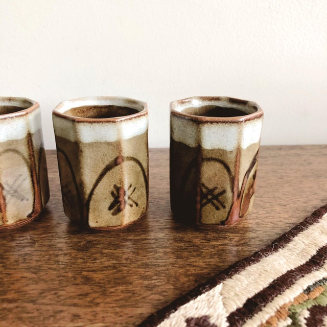 """Lovely set of 4 Asian olive green ceramic sake cups. Each cup: 2.25"""" diameter x 3"""" height"""