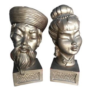 Gilt Asian Man and Woman Head Busts - a Pair
