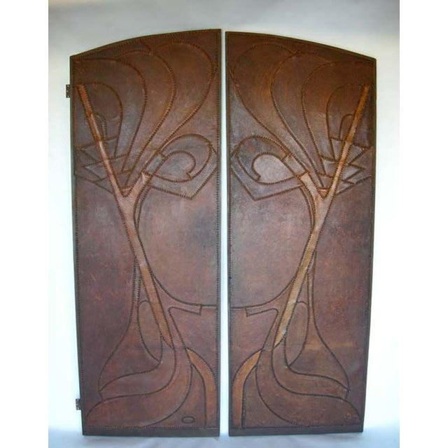 20th century leather doors with applied leather and stud motif. Leather has been completely reconditioned and has...