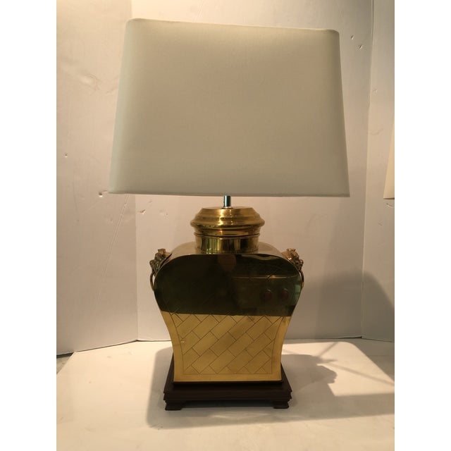 A fabulous pair of vintage brass lamps with new white linen shades. The lamps are etched (front and back) with a cris-...