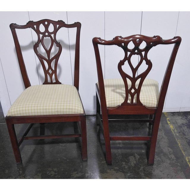 """Set of twelve """"Restall, Brown & Clennell LTD"""" Chippendale dining chairs, Mahogany finish made in England late 1990s with a..."""