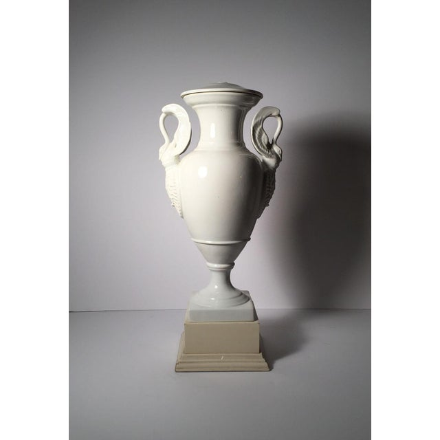 Early 20th century white porcelain Limoges lamp. Swan form handles on a neoclassical urn shaped vase. Please contact to...