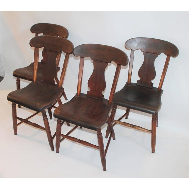 This nice early set of worn salmon painted chairs are from PA and are super comfortable. They have a nice mellow patina....
